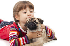 Little girl and the Pug-dog. Isolated on a white background Royalty Free Stock Photo