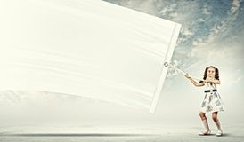 Little Girl Pulling Banner Royalty Free Stock Photos
