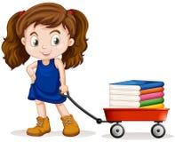 Little girl pulling cart full of books Royalty Free Stock Image