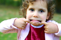 Little girl pulling faces Stock Images