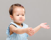 Little girl pulling hand up Stock Photography