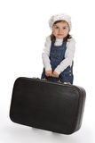 Little girl pulling a heavy suitcase Royalty Free Stock Photography