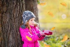 Little girl pulling her hand in autumn park Royalty Free Stock Photography