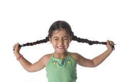 Little Girl Is Pulling Her Pigtails Royalty Free Stock Photos
