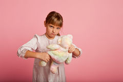 Little girl pulling a teddy bear Royalty Free Stock Image