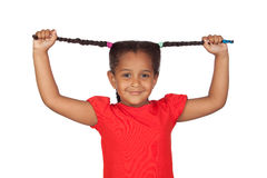 Little girl pulling their long tresses Stock Photo