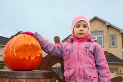 Little girl and pumpkin of Halloween Royalty Free Stock Images