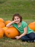 Little Girl in a Pumpkin Patch