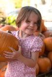 Little girl in pumpkin patch Stock Photos