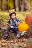 Little girl and pumpkin Royalty Free Stock Images