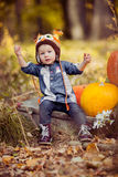 Little girl and pumpkin Royalty Free Stock Image