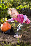 Little girl with a pumpkin Stock Photography