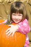 Little Girl with Pumpkins Royalty Free Stock Photo