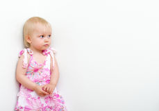 Little girl standing in the corner Royalty Free Stock Photos