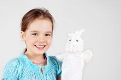 Little girl with puppet Stock Images