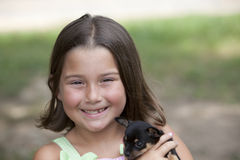 Little girl with puppy Stock Image