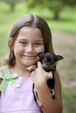Little girl with puppy Stock Photo
