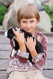 Little girl with the puppy Stock Images