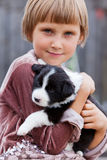Little girl with the puppy. Border Collie Royalty Free Stock Photography