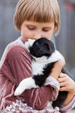 Little girl with the puppy. Border Collie Royalty Free Stock Photo