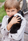 Little girl with the puppy Royalty Free Stock Image