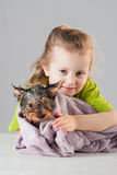 Little girl with puppy after his bath Stock Photo