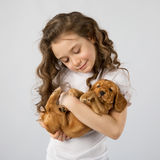 Little girl with puppy isolated on white background. Kid Pet Friendship Stock Image
