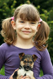 Little girl and puppy portrait Royalty Free Stock Photos