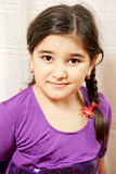 Little girl in purple dress Stock Photos
