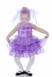 Little girl in purple dress. Stock Photography