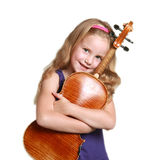 Little girl in purple dress with violin Stock Images