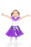Little girl in a purple skirt. Isolated on white Royalty Free Stock Image