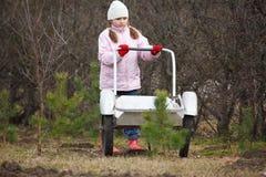 Little girl pushing barrow Royalty Free Stock Image