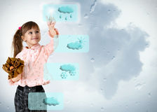 Little girl pushing on weather button stock photography