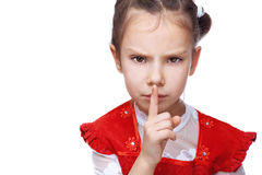 Little girl put her finger to her. Lips as sign of peace, isolated on white background Stock Photography