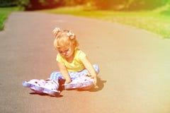 Little girl put on roller skates outdoors Stock Photography