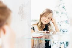 Little girl looking in mirror Stock Images