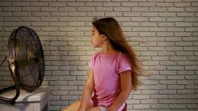 Little girl fan stock video footage