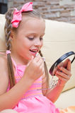 Little girl puts makeup Royalty Free Stock Images