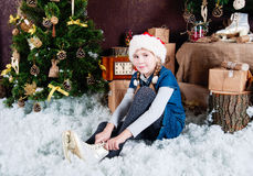 Free Little Girl Puts On The Skates Royalty Free Stock Photo - 79066995