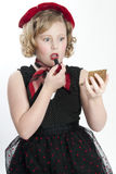 Little Girl Putting on Lipstick Royalty Free Stock Images