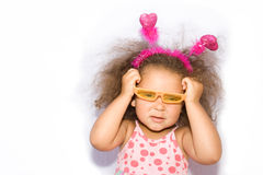 Little Girl Putting Orange Sunglasses Royalty Free Stock Photography