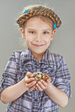 Little girl with quail eggs Stock Photo