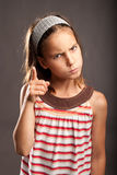 Little girl quarreling Stock Images