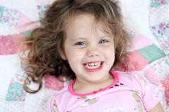 Little Girl on Quilt Royalty Free Stock Image