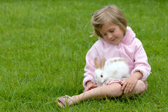 Little girl with a rabbit. The little girl with a rabbit royalty free stock photos