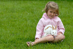 Little girl with a rabbit. The little girl with a rabbit Royalty Free Stock Image