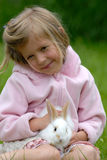 Little girl with a rabbit. The little girl with a rabbit royalty free stock photography
