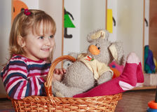 Little girl with rabbit. Little girl with basket playing Stock Images