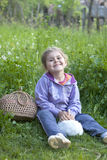 Little girl with rabbit on grass Stock Photo